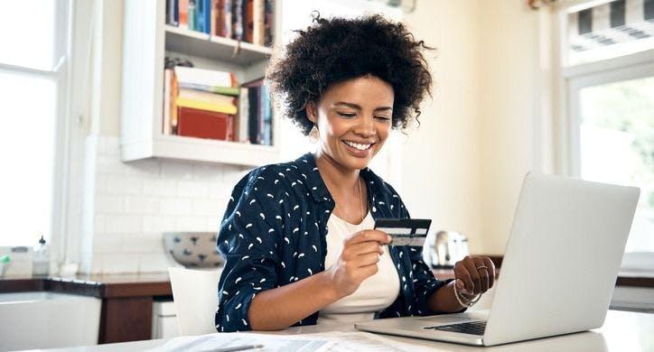 woman-looking-at-payroll-paycard