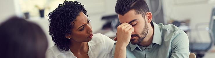 woman comforting man having mental breakdown