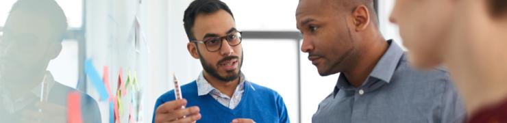 diverse men in meeting